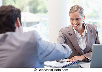 Manager interviewing a male applicant