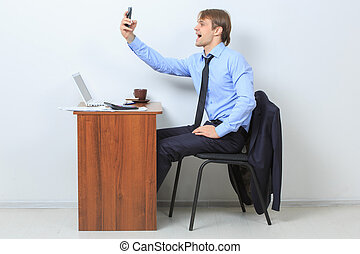 Manager looks to the mobile phone
