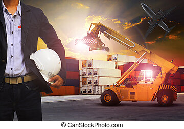 manager man working in container dock use for transportation and container cargo frieght and logistic shipping service industry