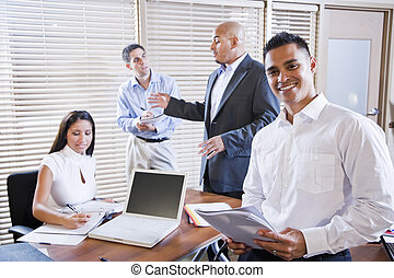 Manager meeting with office workers, directing - Hispanic ...