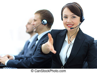 Manager of call center reaches out to shake hands.