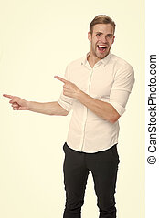 Manager or assistant help find direction. Pointing direction. Man shop assistant pointing index finger isolated on white. Guy handsome shows direction. Look at this advertisement. This way concept