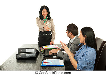 Manager pointing to business woman