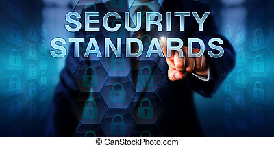 Manager is pressing SECURITY STANDARDS on a touch screen interface. Information technology and computer security concept. Locked padlock icons in a uniform layout signify standard implementation.