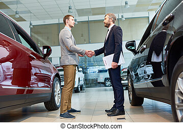 Manager Selling Cars in Showroom