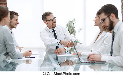 Manager shaking business partner
