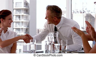 Manager shaking hands with employee