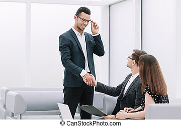 Manager shaking the hand of the Bank customer.
