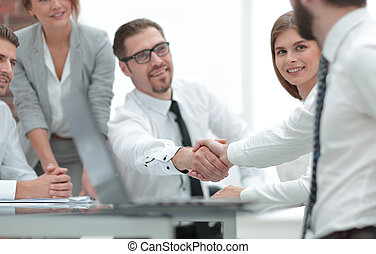 Manager shaking the hand of the customer