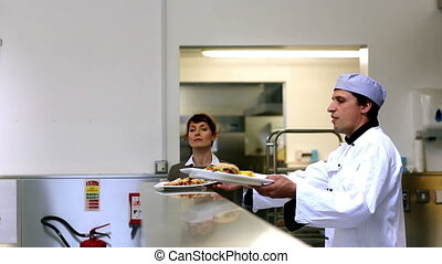 Manager supervising the order stati