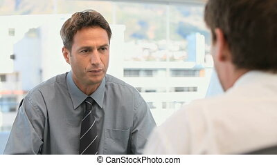 Manager talking with an employee