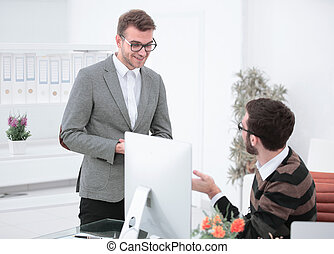 Manager talking with an employee in the office.