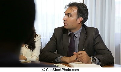 manager talks and listens at a business meeting
