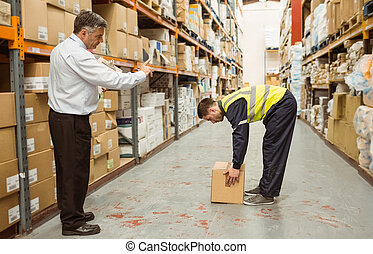 Manager watching worker
