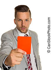manager with red card - a manager holding a red card in...