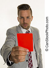 manager with red card - a manager holds a red card in his...