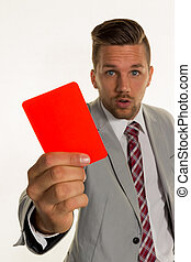 manager with red card - ein manager holds a red card in hand...