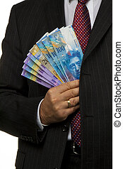 Manager with Swiss franc banknotes