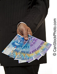 Manager with Swiss franc banknotes - Manager with Swiss...