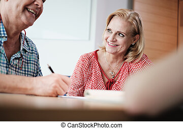 Manager Working As Banking Broker With Old Couple Signing Contract