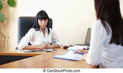 Manager Working With Customer - Businesswoman working with...