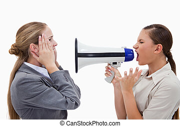 Manager yelling at her employee through a megaphone