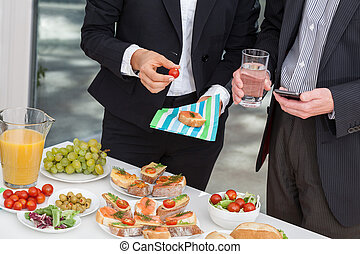 Managers at business lunch - Managers at office buffet...
