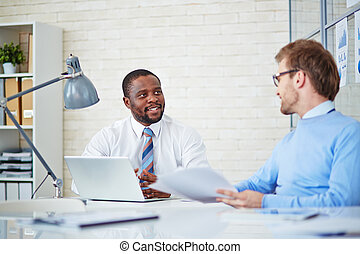 Managers consulting - Young businessmen interacting at...