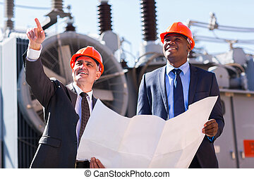 managers working in electrical substation