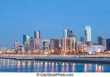 Skyline of Manama city illuminated at night. Kingdom of Bahrain, Middle East