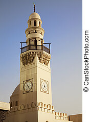 Image of a small mosque right in the middle of the city in Manama, Bahrain.