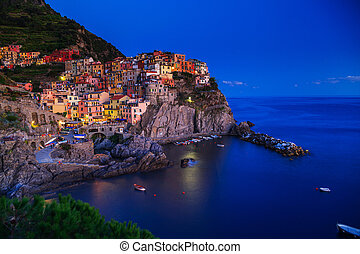 Manarola, Liguria, Italy. The wonderful Manarola village. Quiet sky and peaceful sea, during sunset.