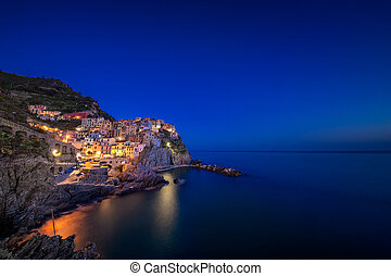 Manarola town during blue hour at night