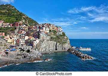 Manarola village on cliff rocks . Seascape in Five lands, Cinque Terre National Park, Liguria Italy Europe.