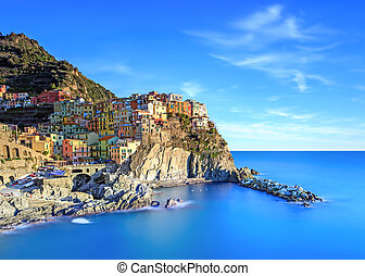 Manarola village, rocks and sea at sunset. Cinque Terre, Italy