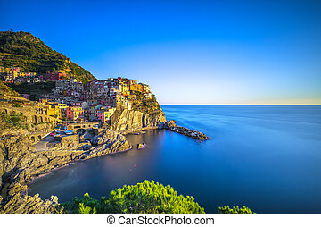 Manarola village, rocks and sea. Cinque Terre, Italy. Long Exposure.