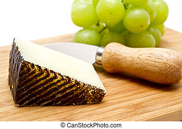 Manchego cheese ang grapes on chopping board - Manchego...