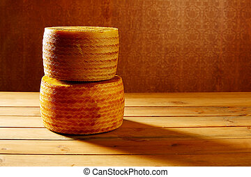 Manchego cheese from Spain in wooden table stacked