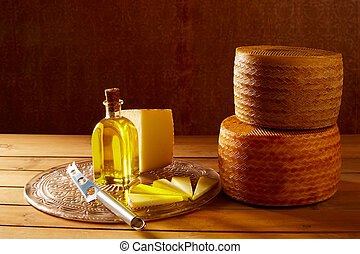 Manchego cheese from Spain in wooden table with andalusian...