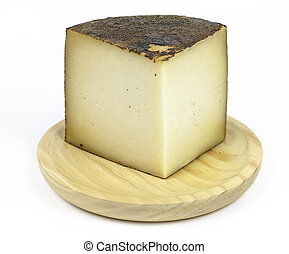 manchego cheese, typical of Spain, isolated on a white...