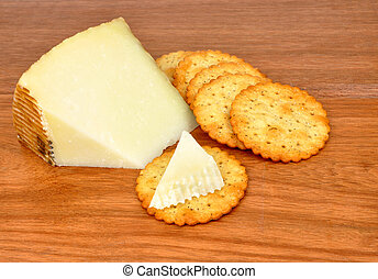 Manchego Cheese - Wedge of traditional Manchego cheese and...