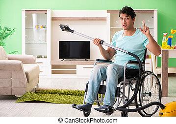 mand disabled, på, wheelchair, vakuum, rensning hus