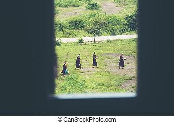 Mandalay, Burma - August 24: Buddhist Burmese monks are walking hike at Mandalay, Burmar on August 24, 2017