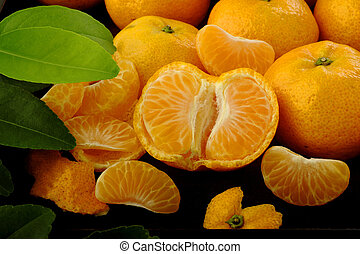 Mandarin orange in wooden tray