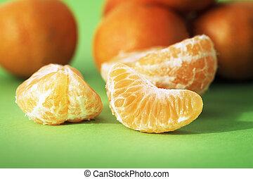 Mandarin Orange - Mandarin orange segments on green...