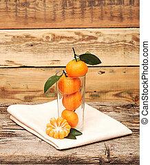 mandarinok, alatt, egy, pohár.