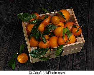 Mandarins in a wooden box