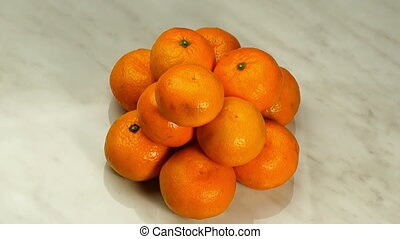 Mandarins in the Form of a Pyramid