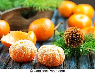 mandarins - fresh mandarins on a table, christmas background