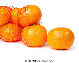 Mandarins getting out from a broken net bag-over white...